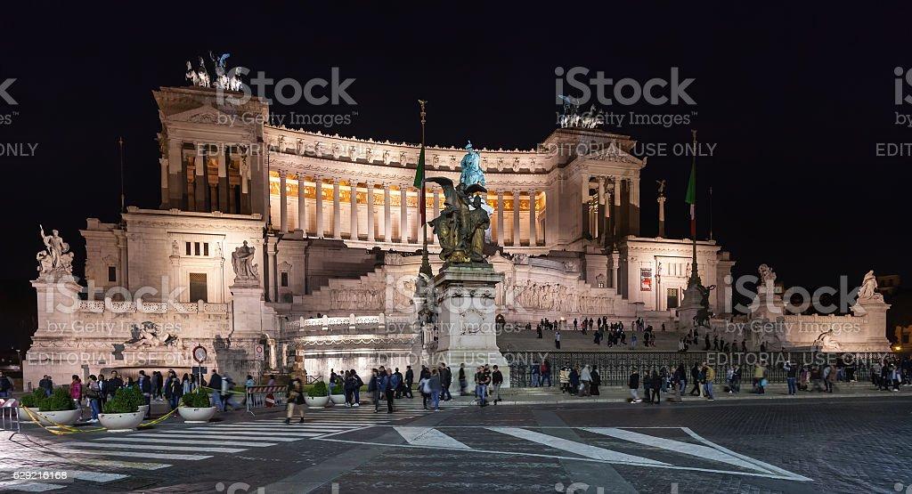 tourists near Altare della Patria in night stock photo