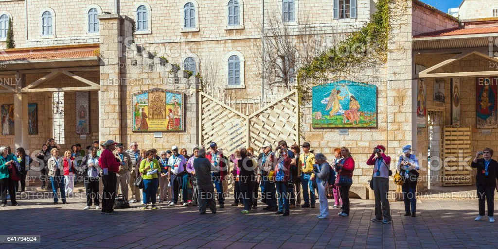 NAZARETH, ISRAEL - FEBRUARY 21, 2013: Tourists near Annunciation Cathedral stock photo