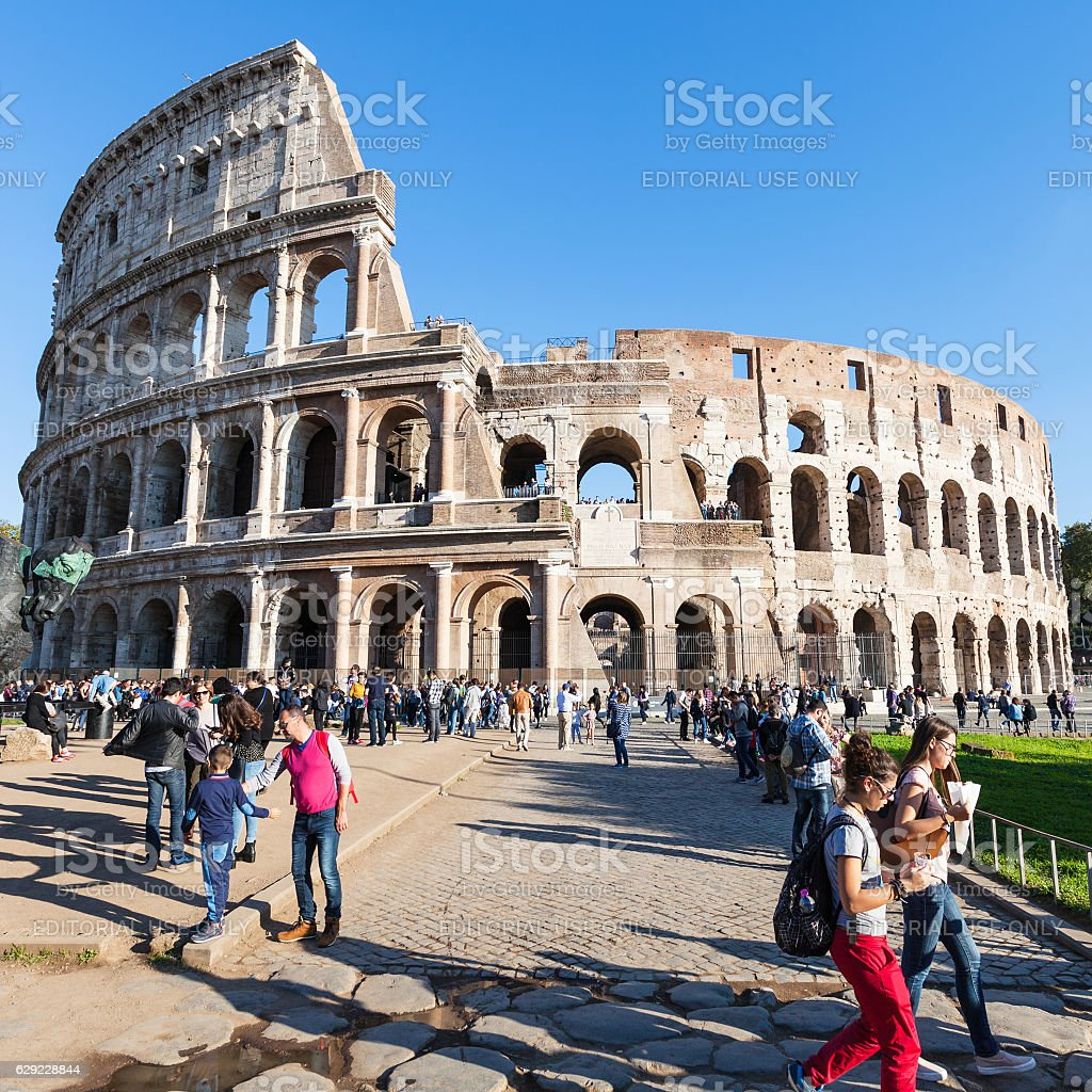 tourists near Colosseum monument in Rome city stock photo
