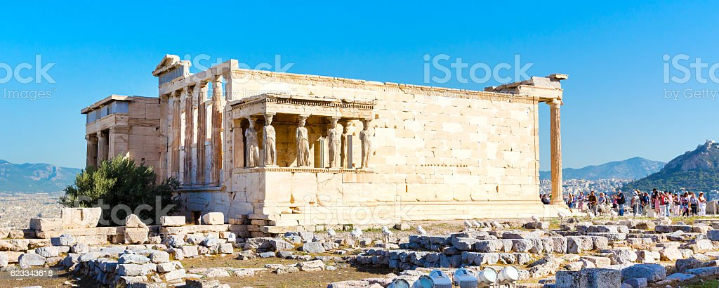 Tourists near Erechtheum temple ruins in Acropolis, Athens banner background stock photo