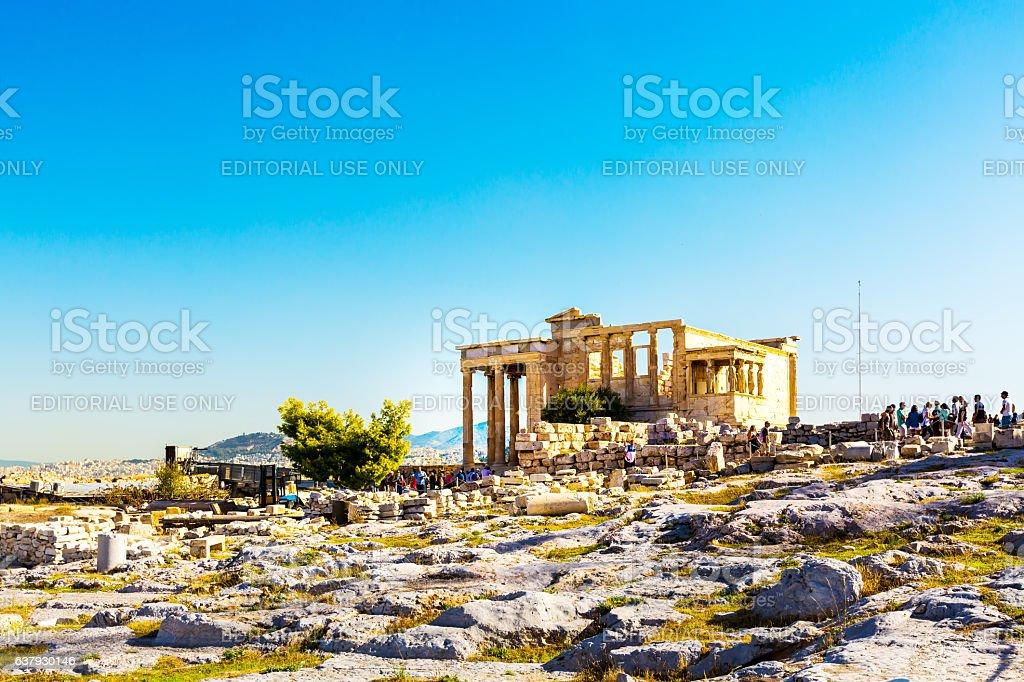 Tourists near Erechtheum temple ruins in Acropolis, Athens stock photo