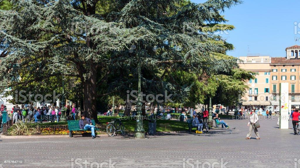 tourists near garden on Piazza Bra in Verona stock photo