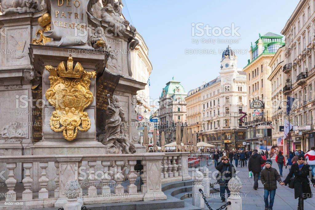 tourists near Plague column on Graben street stock photo