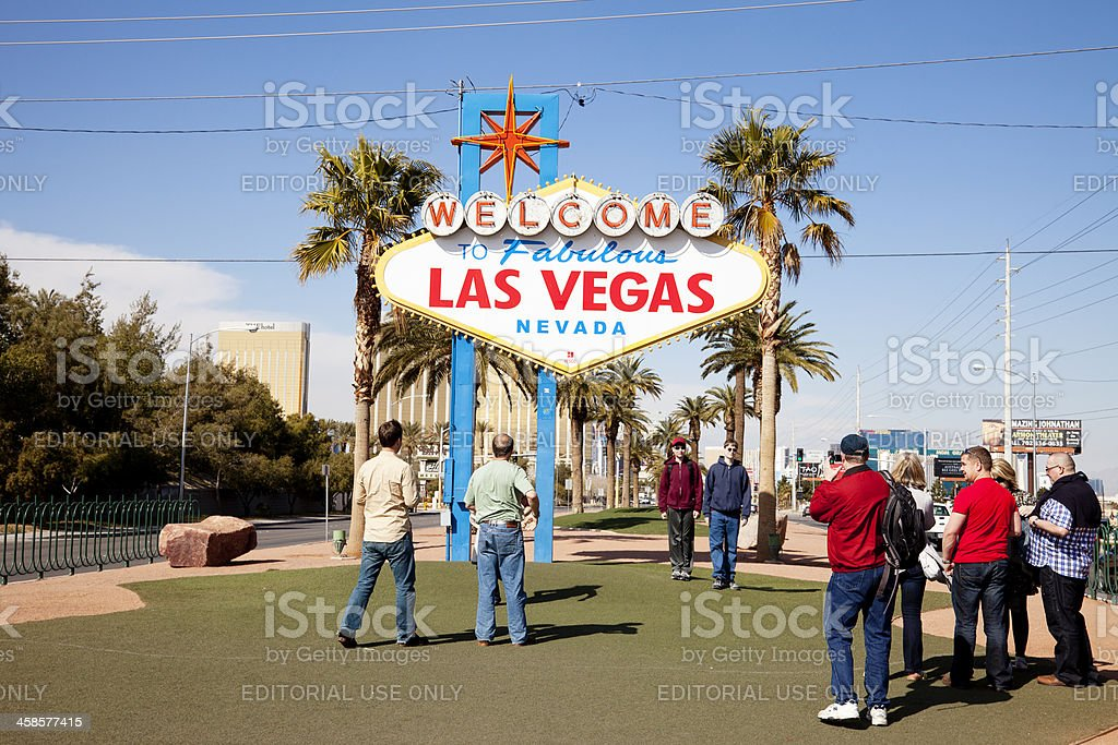 """Tourists near """"Welcome to fabulous Las Vegas sign"""" royalty-free stock photo"""