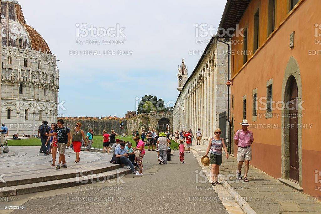 Tourists near the Baptisery of St. John in Pisa, Italy stock photo