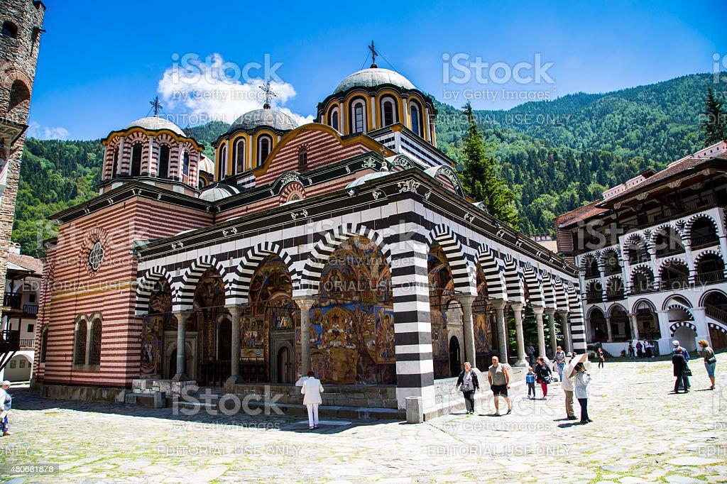 Tourists near the church in famous Rila Monastery, Bulgaria stock photo