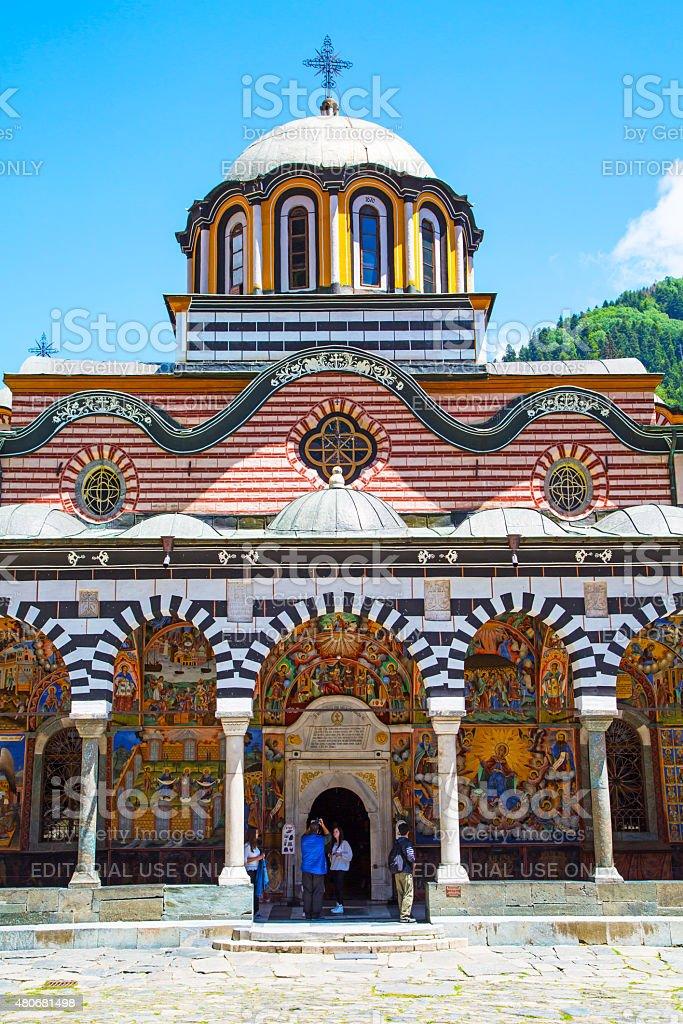 Tourists near the church in Rilsky monastery, Bulgaria stock photo