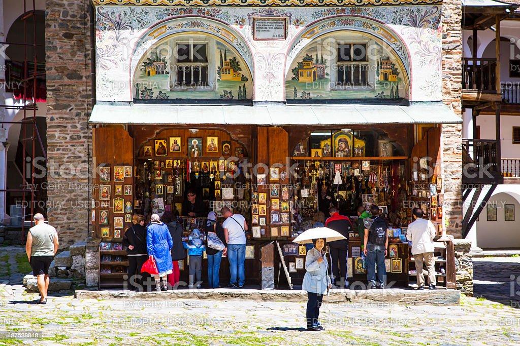 Tourists near the icon shop in famous Rila Monastery, Bulgaria stock photo