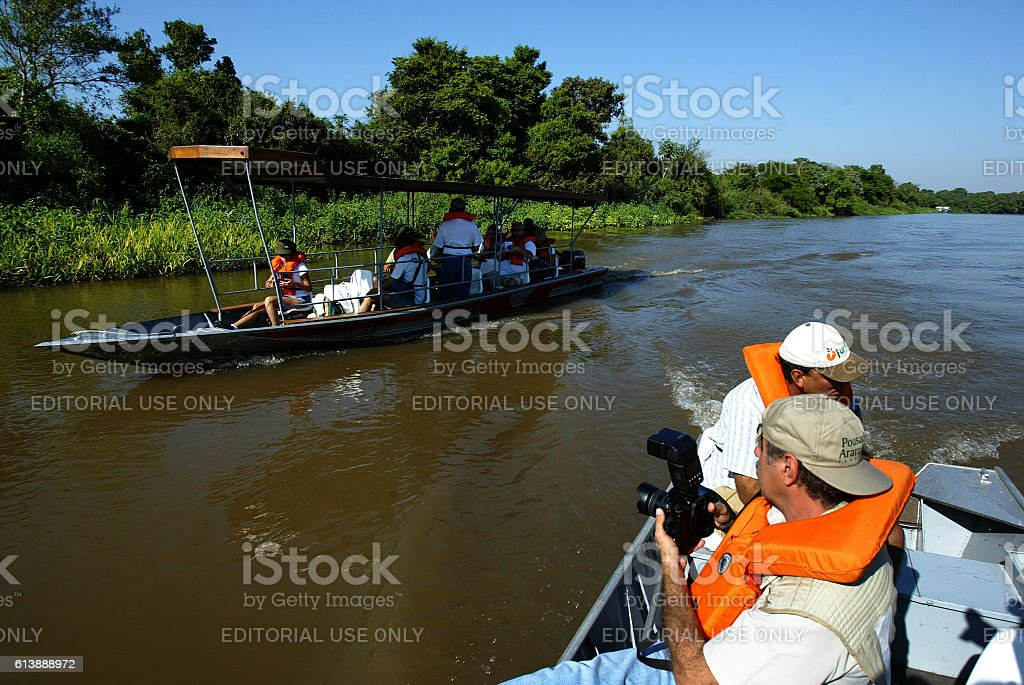 Tourists on a boat ride in the Pantanal South, Brazil stock photo