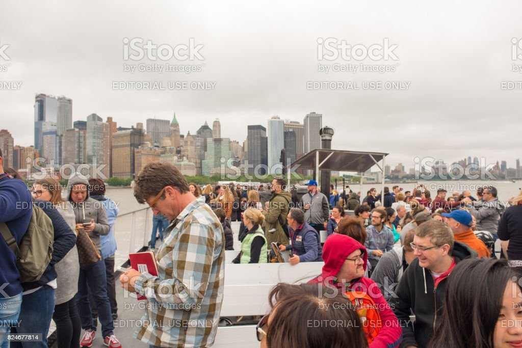 Tourists on a boat to go see the Statue of Liberty stock photo