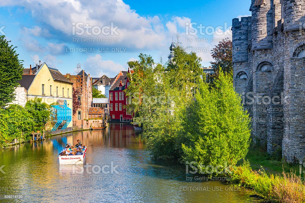 Tourists on a boat tour along the canals of Ghent stock photo