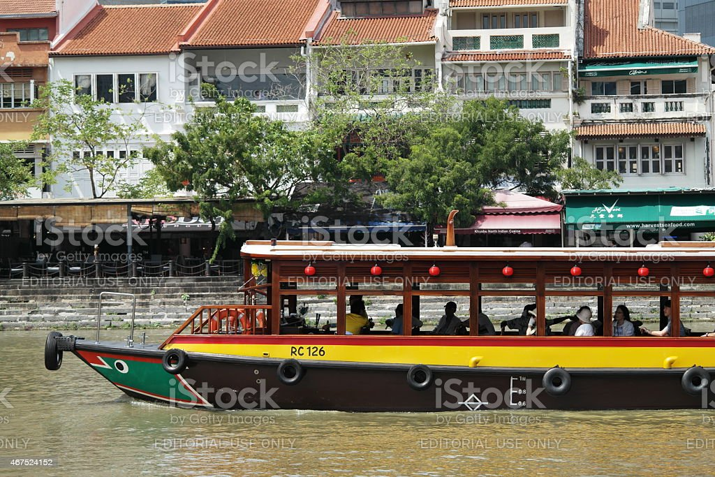 Tourists on a boat tour in Singapore stock photo