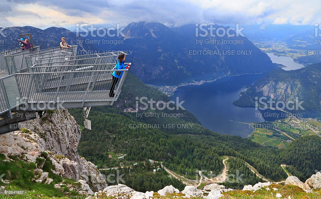 Tourists on a Five Fingers platform, Austria. stock photo