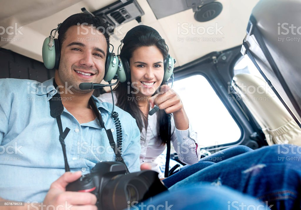 Tourists on a helicopter stock photo