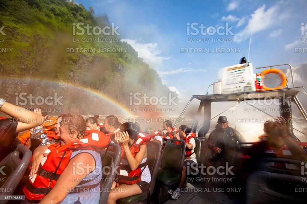 Tourists on an Iguazu falls boat tour in Argentina stock photo