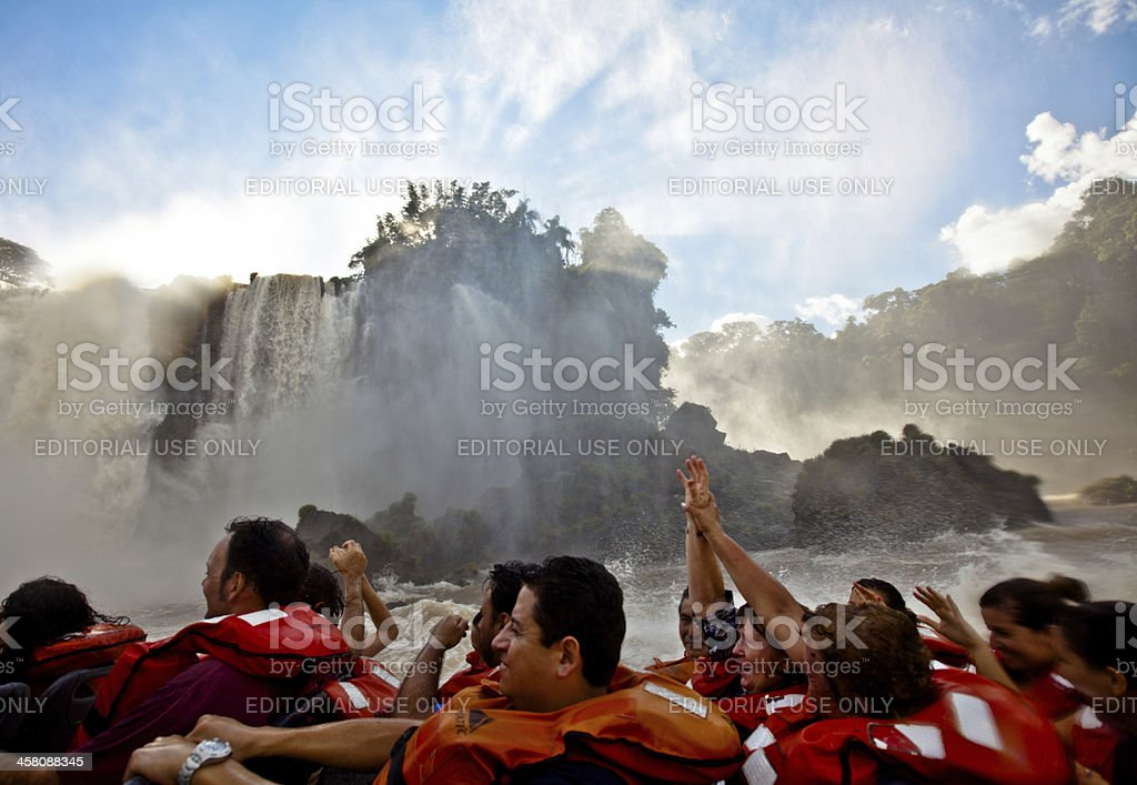 Tourists on an Iguazu falls boat tour in Argentina stock photo