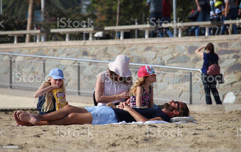 Tourists on Barcelona beach stock photo