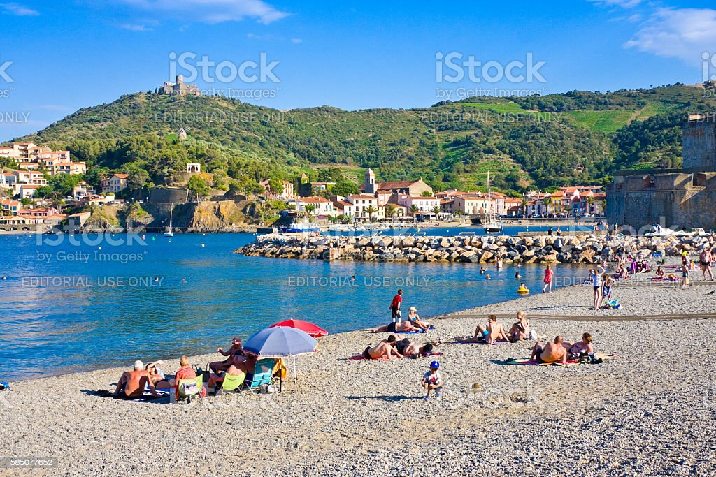 Tourists on beach and  hotels in Collioure, Roussillon stock photo