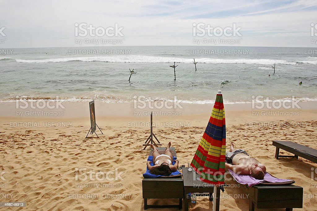 Tourists on beach royalty-free stock photo