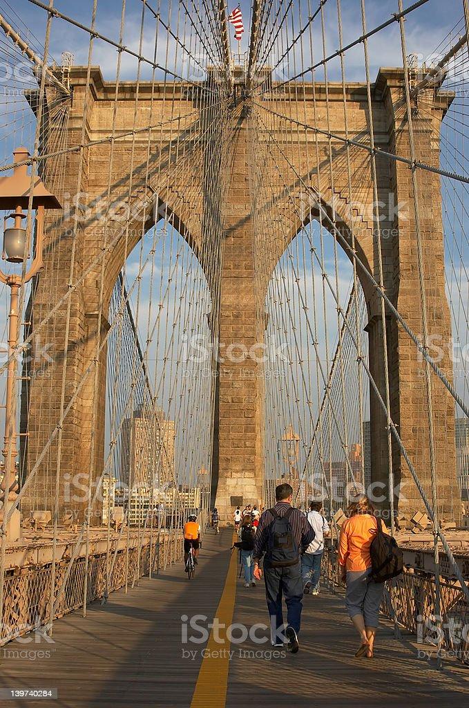Tourists on Brooklyn Bridge royalty-free stock photo