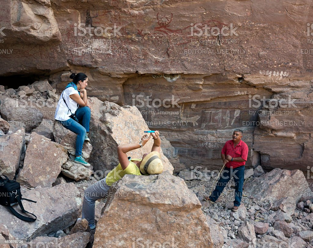 Tourists on desert excursion to see Pre-historic rock art, Mexico stock photo