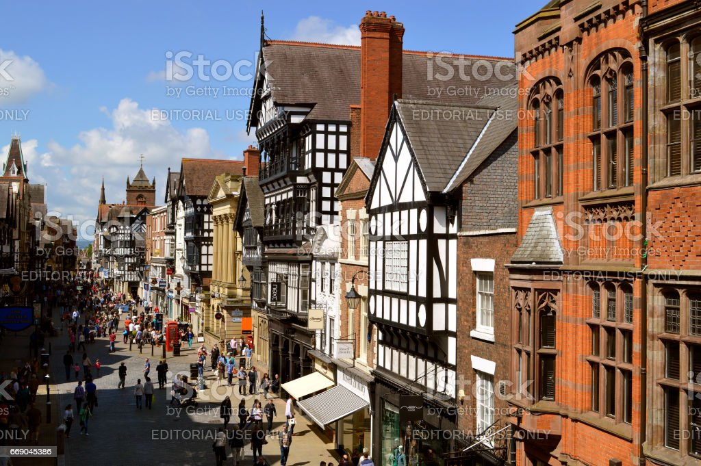 Tourists on Eastgate street in Chester stock photo