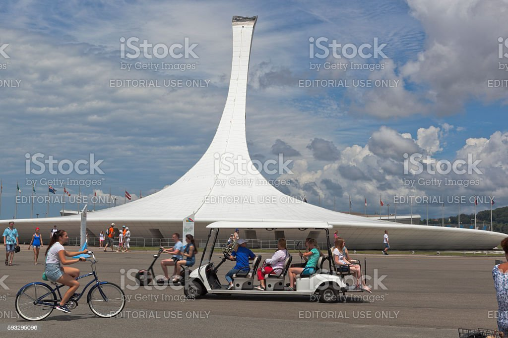 Tourists on environmental transport in Sochi Olympic Park stock photo