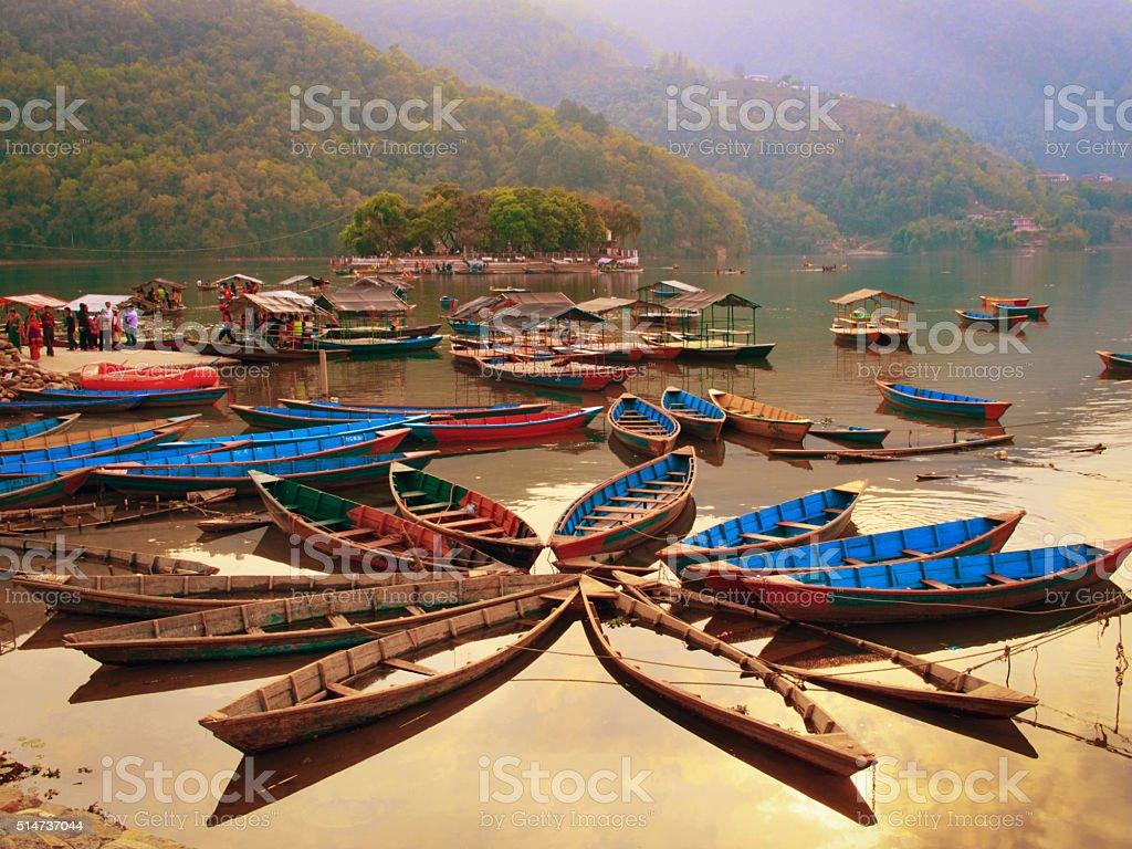tourists on Fewa lake  in Pokhara, Nepal. stock photo