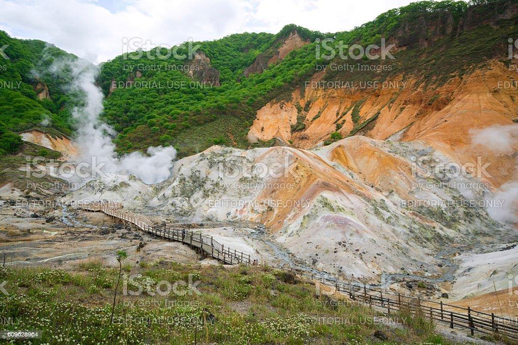 Tourists on Hell Valley Trail on Hokkaido, Japan stock photo