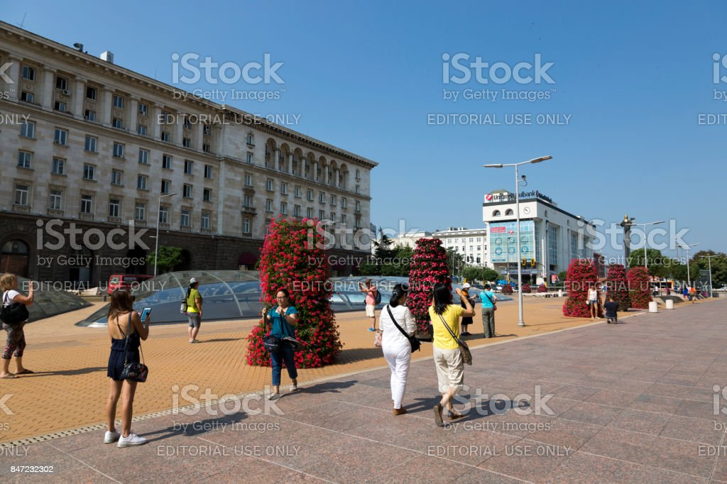 Tourists on Independence Square in Sofia, Bulgaria. stock photo