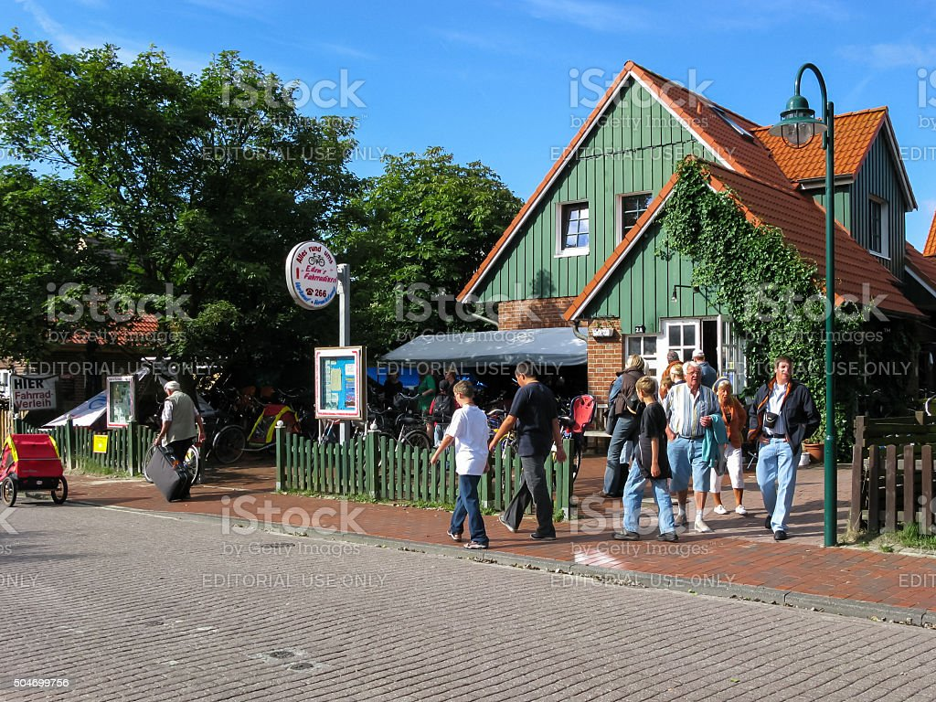 Tourists on island Wangerooge, Germany stock photo