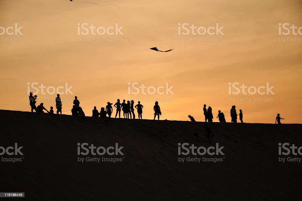 Tourists on Jockey's Ridge stock photo