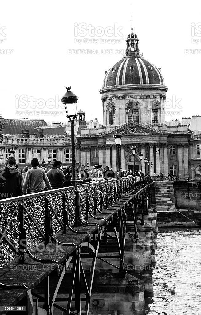 Tourists on Lovelocks bridge and Academy of Fine Arts building. stock photo