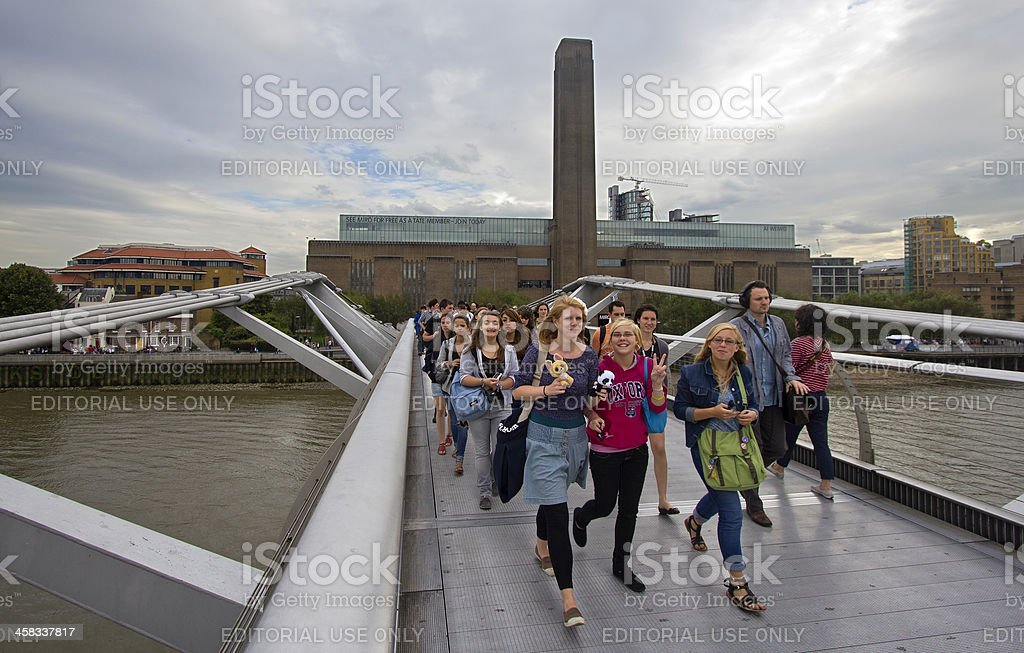 Tourists on Millennium Bridge stock photo