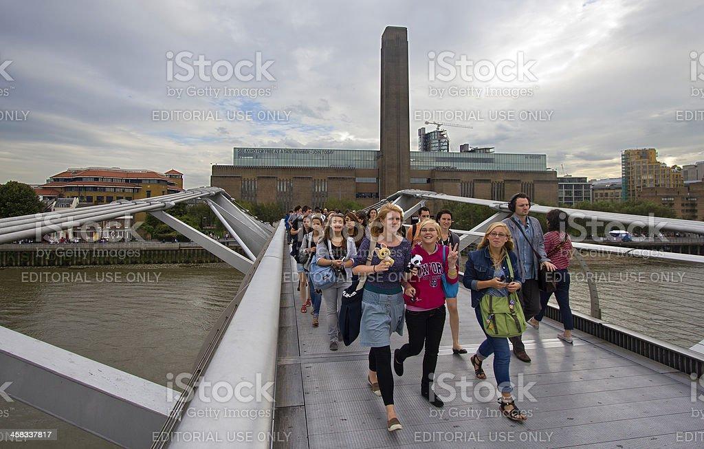 Tourists on Millennium Bridge stock photo