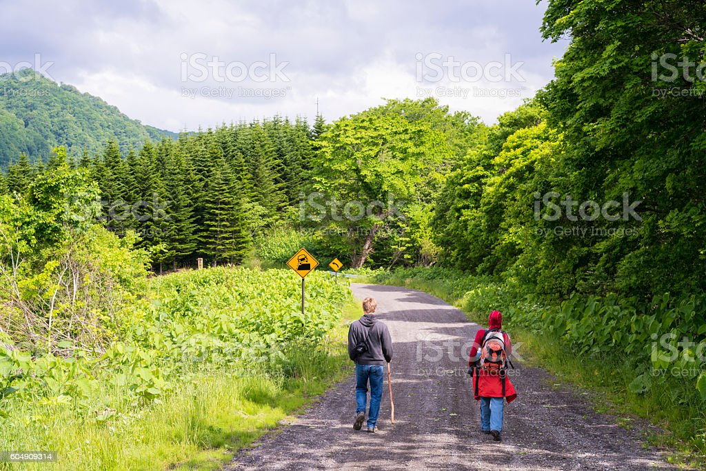 Tourists on Mount Konpira road on Hokkaido, Japan stock photo