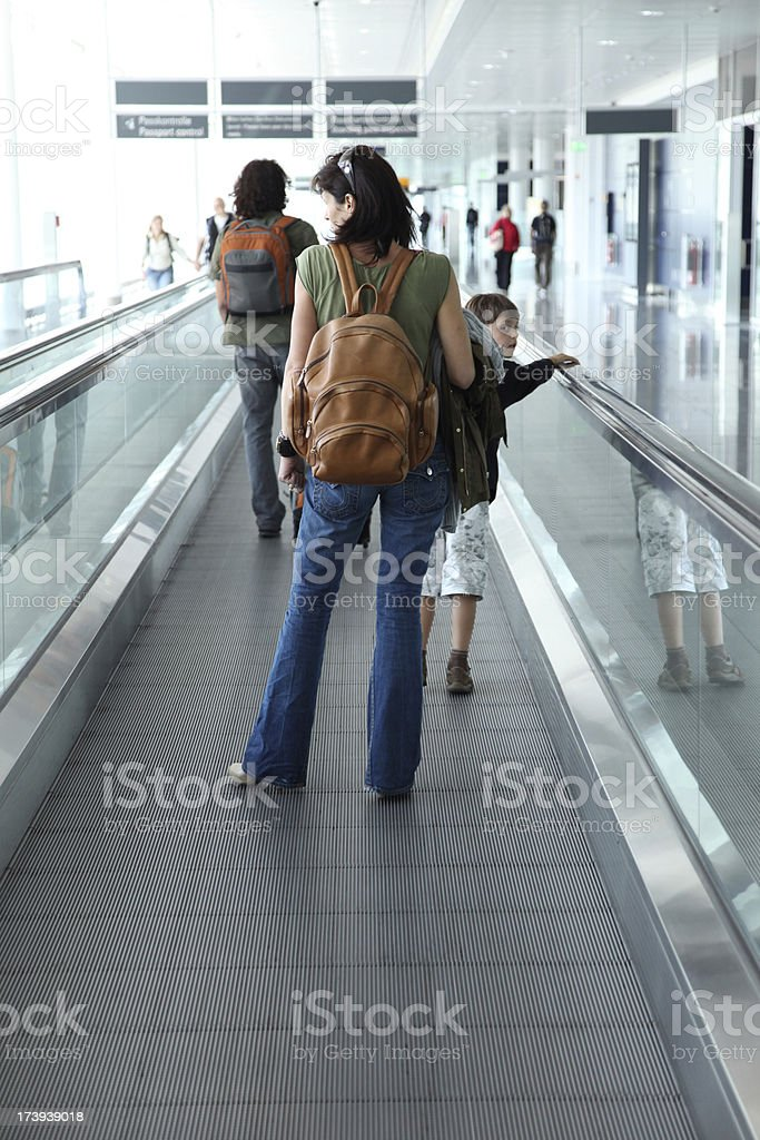 tourists on moving walkway at airport royalty-free stock photo