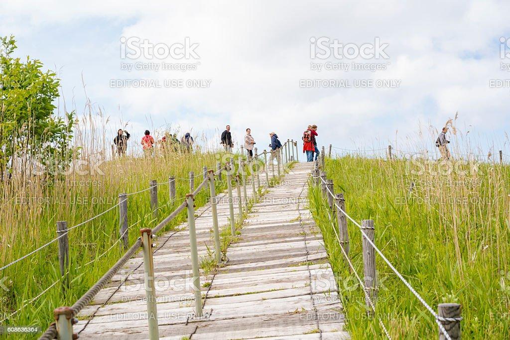 Tourists on Nishiyama walking trail on Mount USU, Hokkaido, Japan stock photo