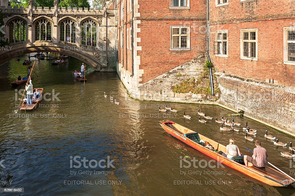 Tourists on punt trip along River Cam. Cambridge, UK royalty-free stock photo
