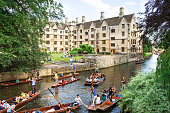 Tourists on punt trip along River Cam. Cambridge, UK