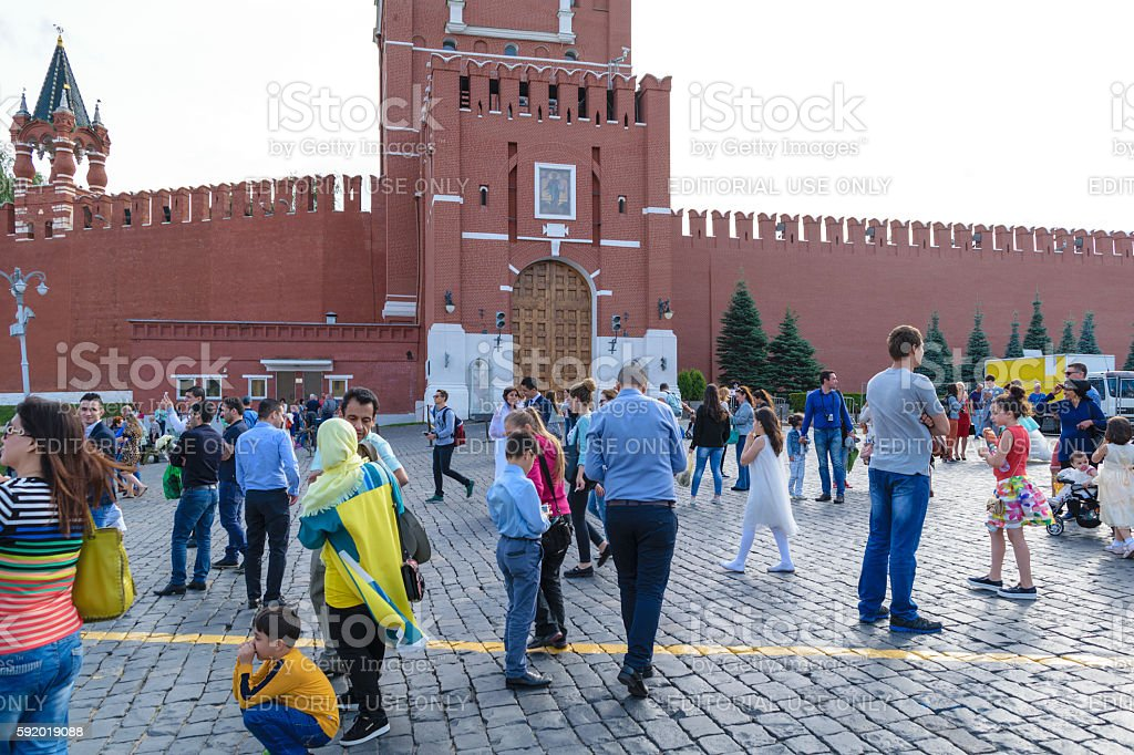 Tourists on Red Square in front of Kremlin wall stock photo