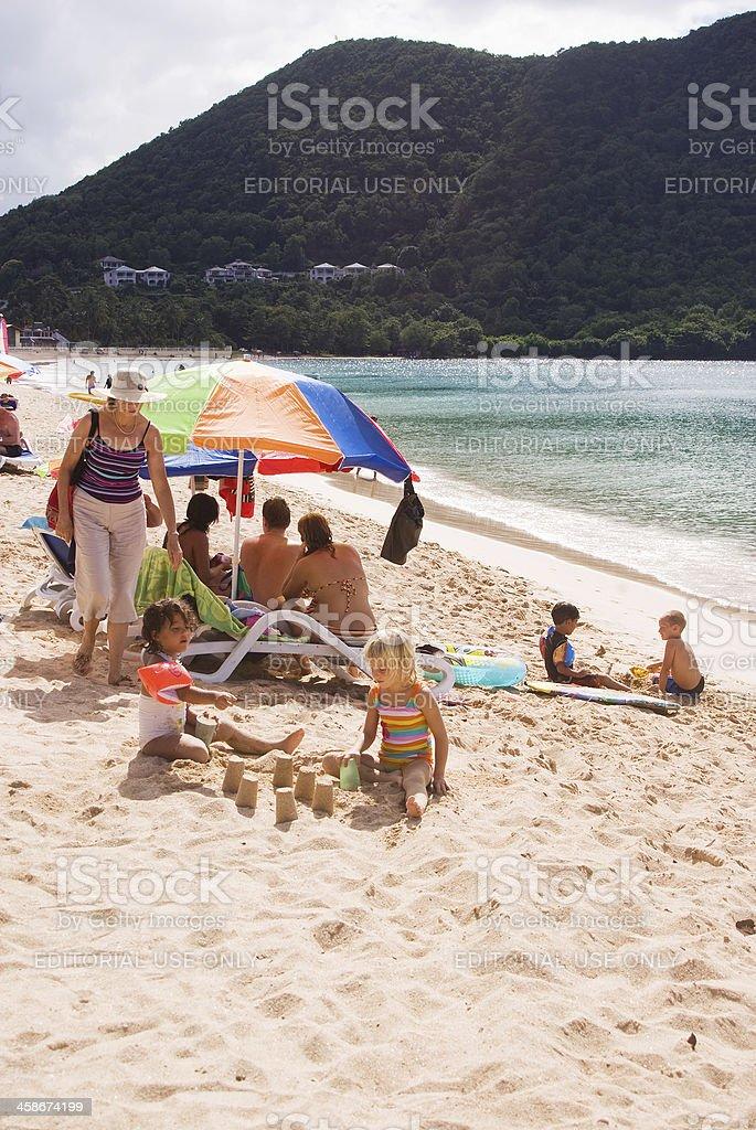 tourists on reduit beach st lucia stock photo