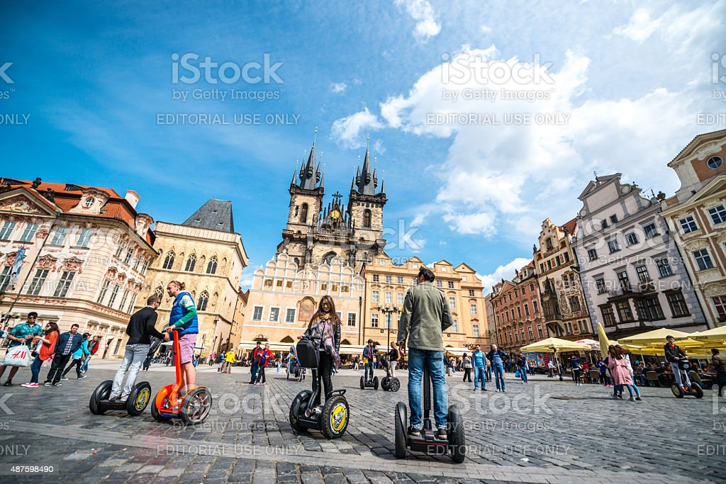 Tourists on segways visiting Prague old town square stock photo