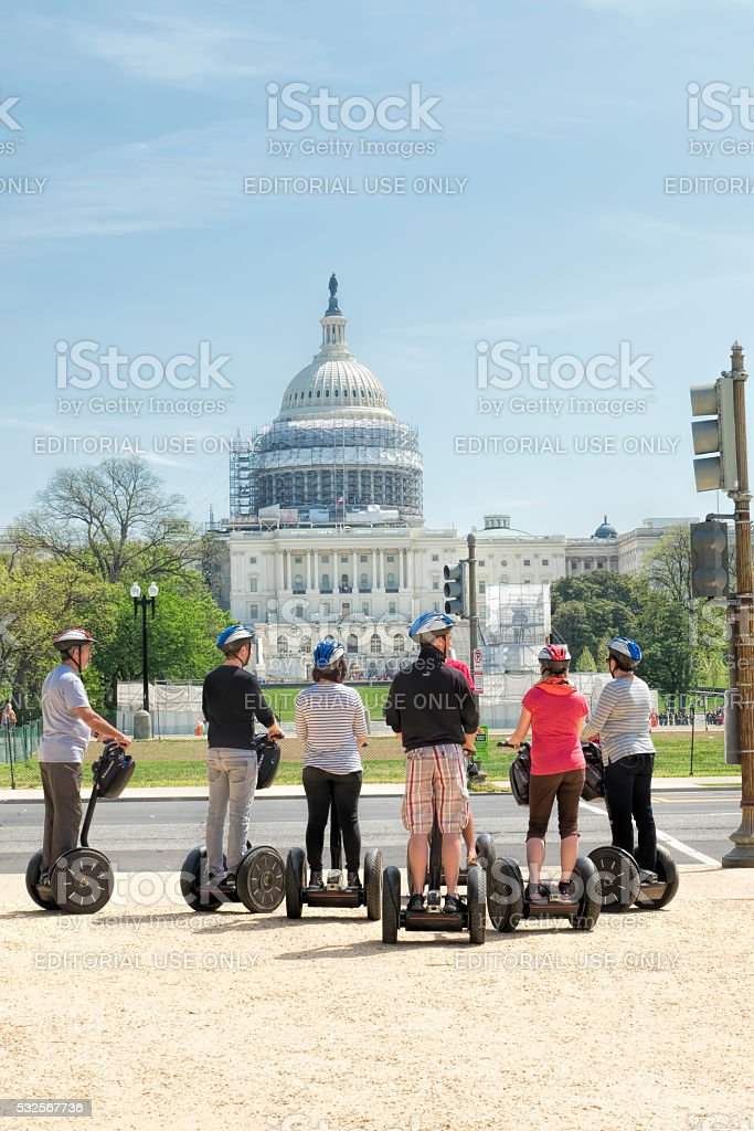 Tourists on segways visiting United States Capitol building stock photo
