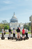 Tourists on segways visiting United States Capitol building