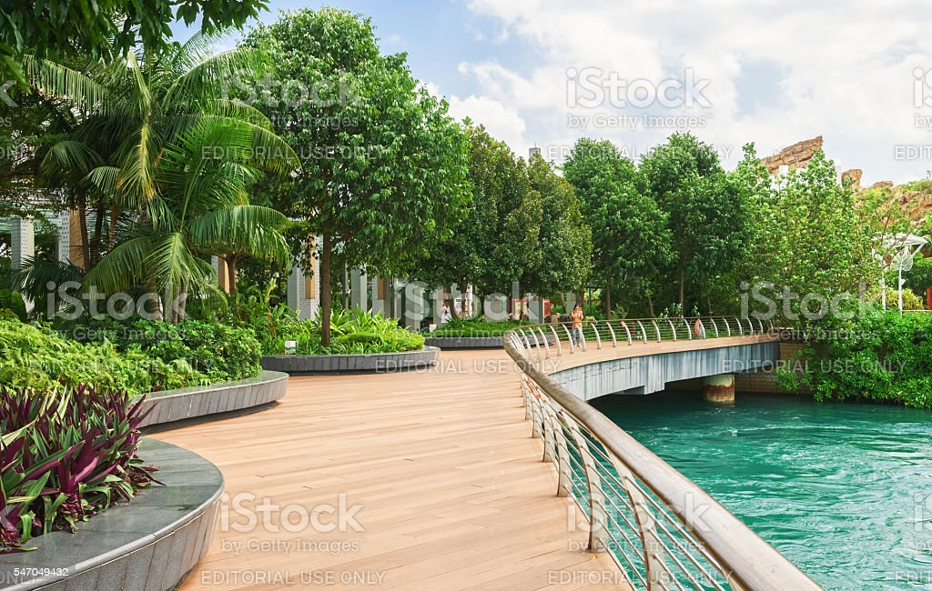 Tourists on Sentosa Boardwalk leading to Sentosa Island of Singapore stock photo