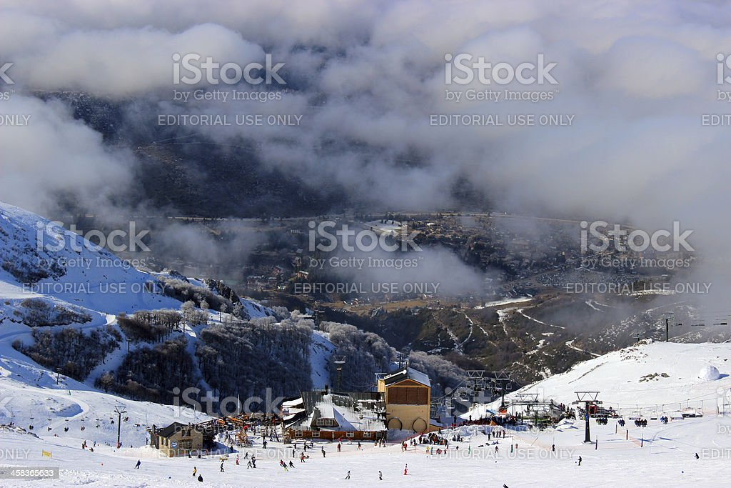 Tourists on Ski station CERRO CATEDRAL - clouds height stock photo