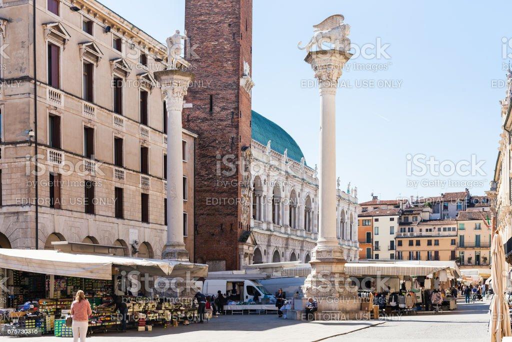 tourists on street market on Piazza dei Signori stock photo