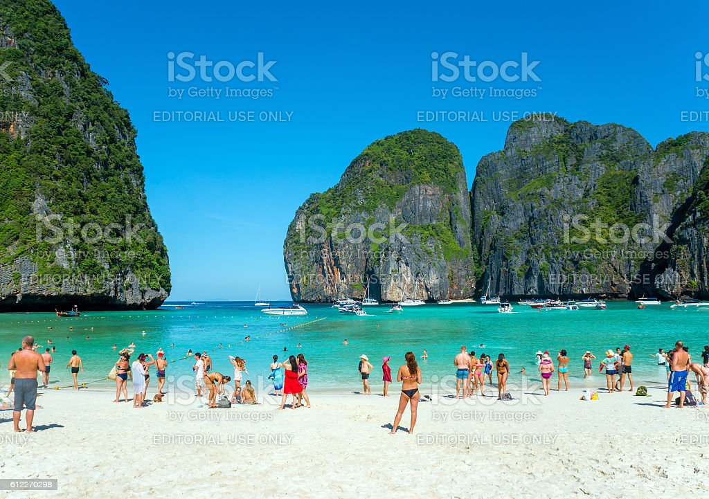 Tourists on the beach of Maya Bay. stock photo