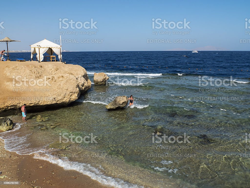 Tourists on the beach of Red Sea royalty-free stock photo